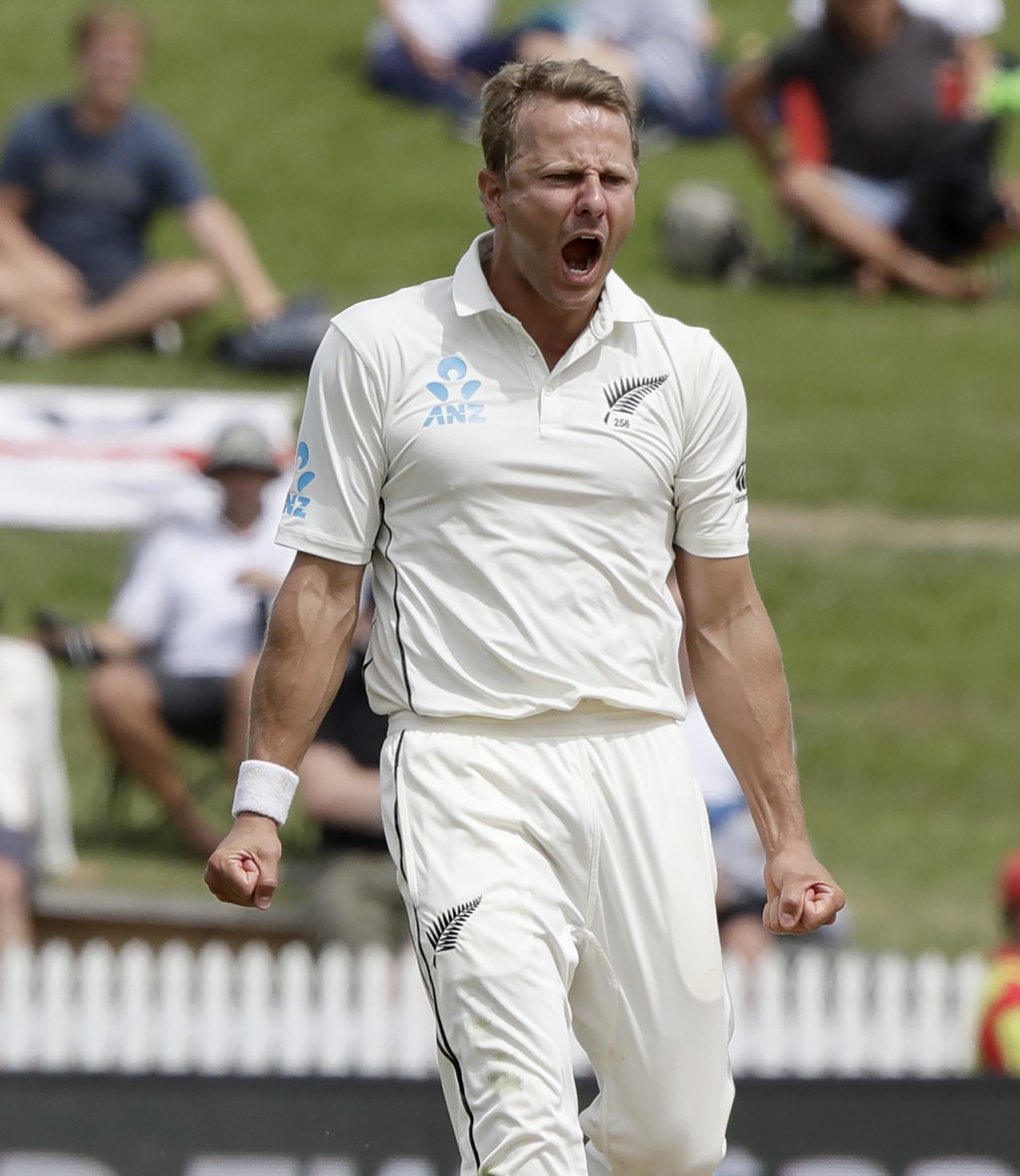 New Zealand's Neil Wagner celebrates after taking the wicket of England's Chris Woakes during play on day four of the second cricket test between Engl...