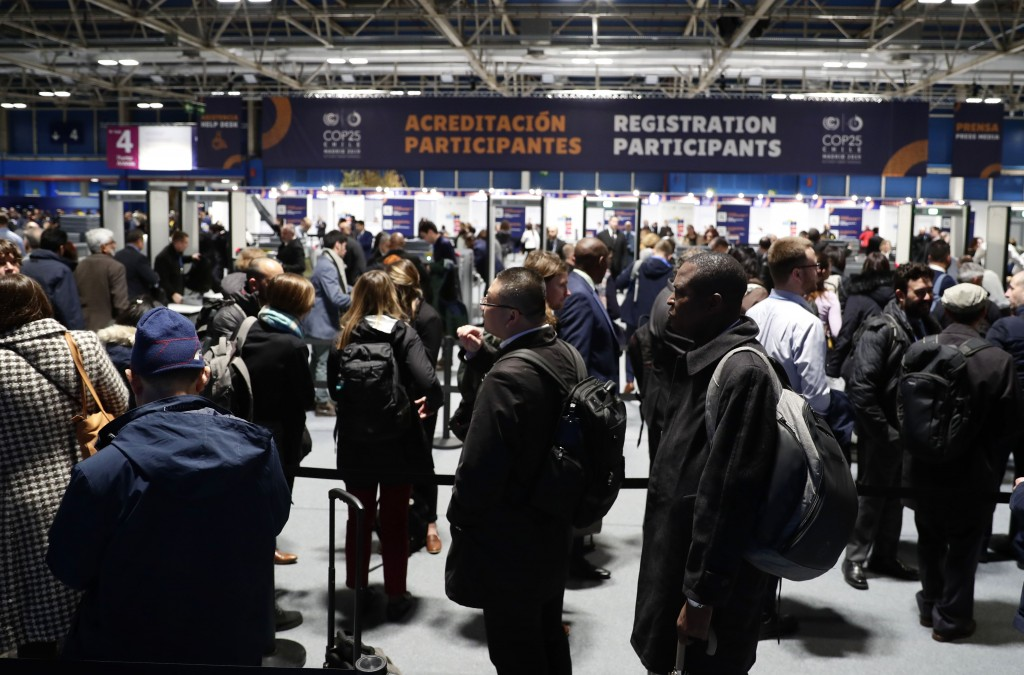 Attendees queue at one of the security control at the COP25 climate talks summit in Madrid, Monday Dec. 2, 2019. U.N. Secretary-General Antonio Guterr...