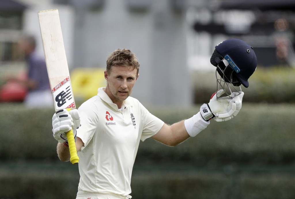 England's Joe Root waves to the crowd as he leaves the field after he was dismissed for 226 runs during play on day four of the second cricket test be...