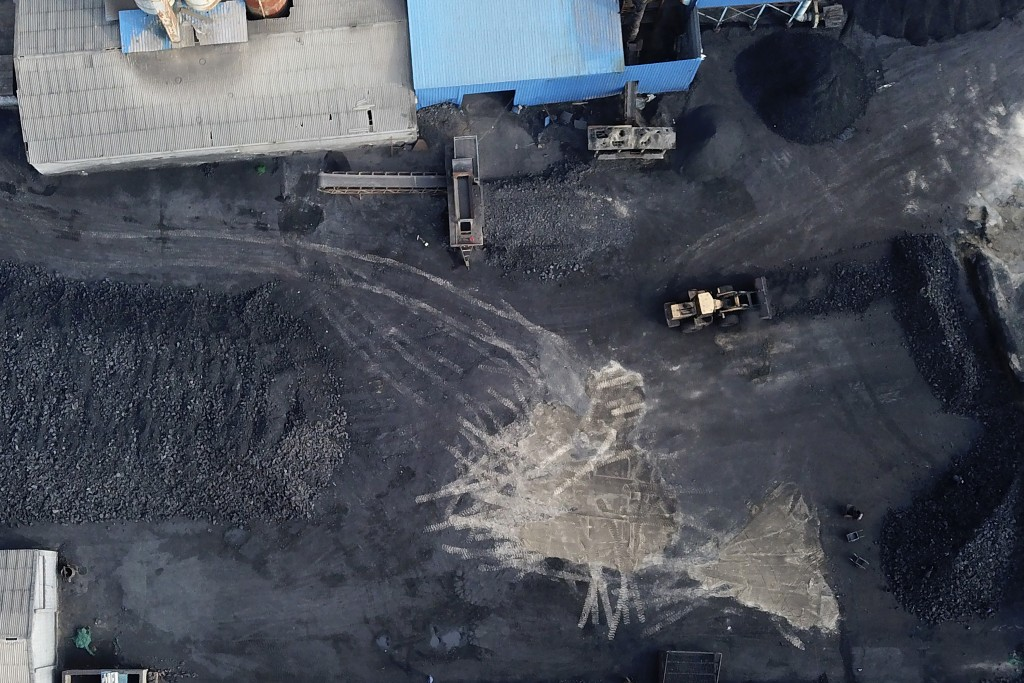 In this Nov. 28, 2019, photo, a coal storage facility is seen in Hejin in central China's Shanxi Province. As world leaders gather in Madrid to discus...