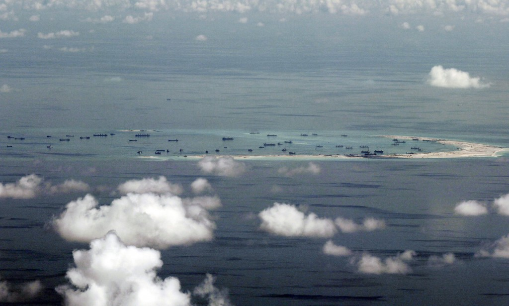 FILE - This May 11, 2015, file photo, shows land reclamation of Mischief Reef in the Spratly Islands in the South China Sea. China has reportedly depl...