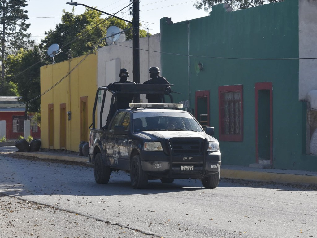 Police patrol VIlla Union, Mexico, Sunday, Dec. 1, 2019, the day after it was assaulted by gunmen. Mexican security forces on Sunday killed seven more...