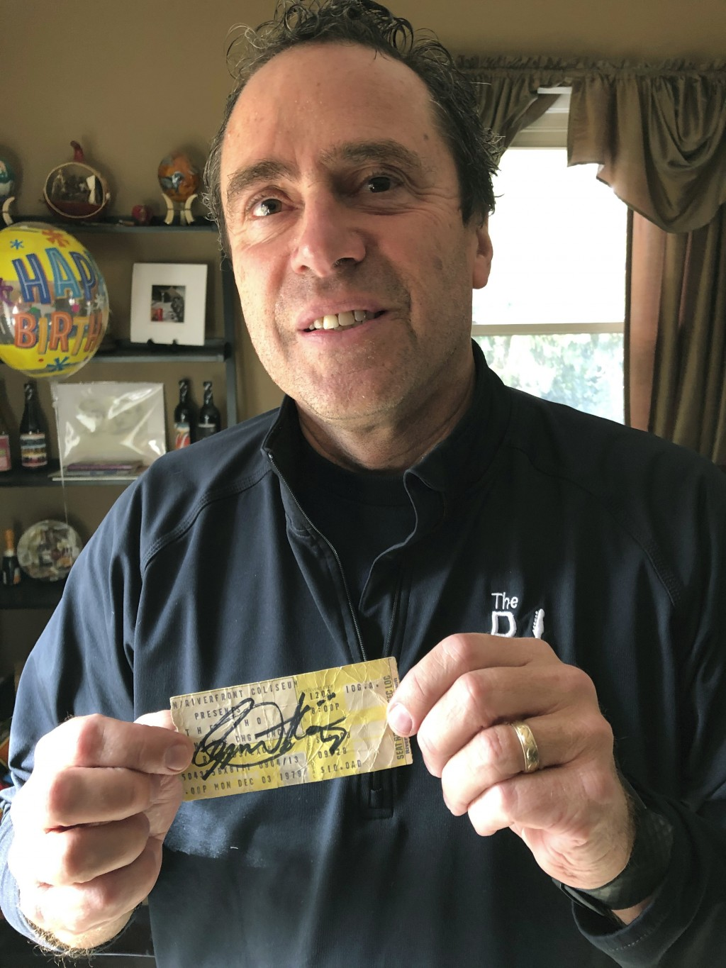 In this Nov. 25, 2019 photo, Finneytown High School alumnus John Hutchins displays a Dec. 3, 1979, concert ticket signed in 2018 by The Who's vocalist...