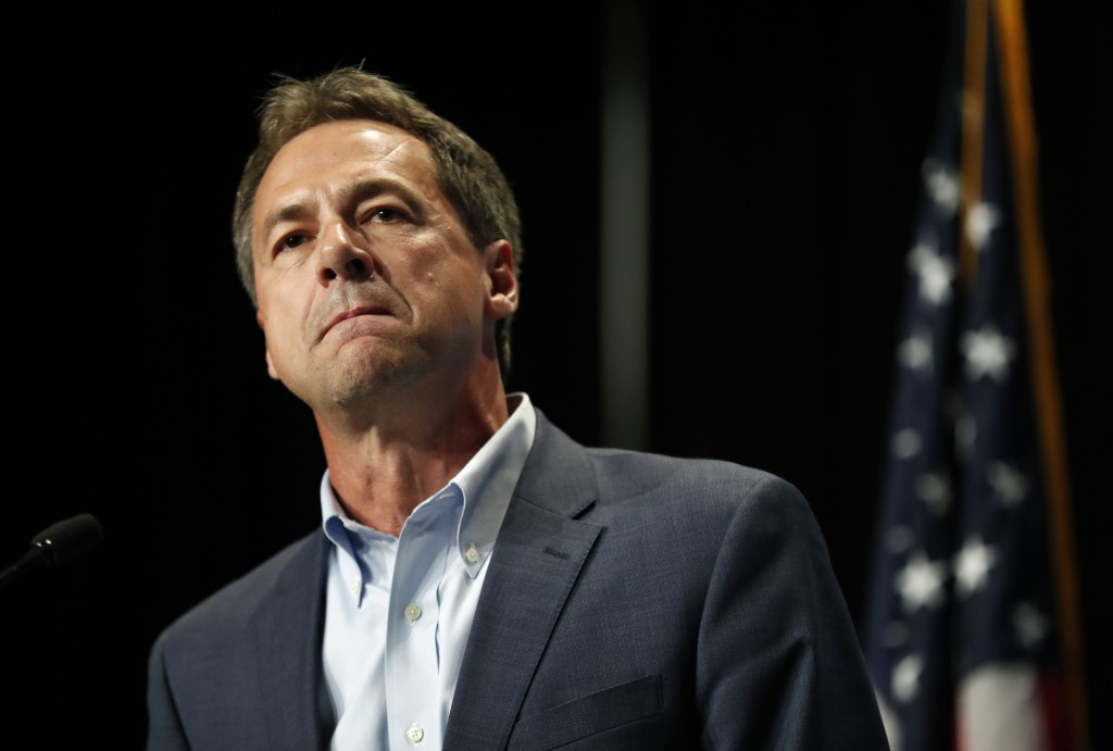 FILE - In this Sunday, June 9, 2019, file photo, Democratic presidential candidate Steve Bullock speaks during the Iowa Democratic Party's Hall of Fam...