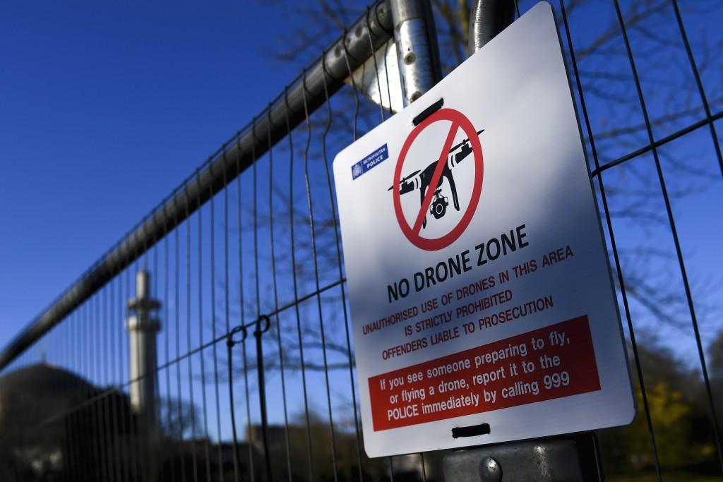 A No Drone Zone sign is posted on a fence which has been set up around Winfield House, the US Ambassador's residence as US President Donald Trump is s...