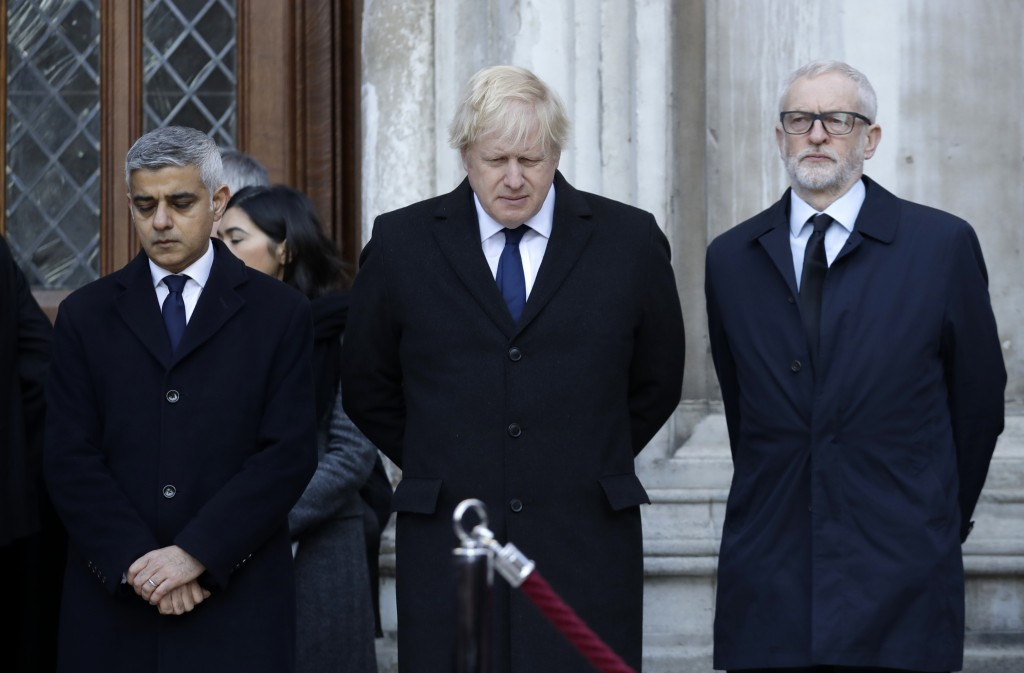 Britain's Prime Minister Boris Johnson, center, Labour Party leader Jeremy Corbyn, right, and Mayor of London Sadiq Khan take part in a vigil at Guild...
