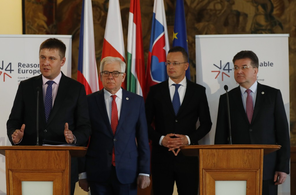 Czech Republic's Foreign Minister Tomas Petricek, left, addresses media together with his counterparts Jacek Czaputowicz of Poland, 2nd left, Miroslav...