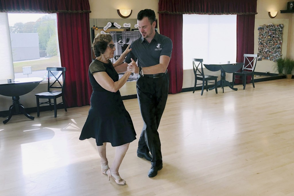 In this Oct. 7, 2019, photo, dance instructor Ned Pavlovic, a native of Serbia, teaches his student Rouhy Yazdani, a native of Iran who now lives in M...