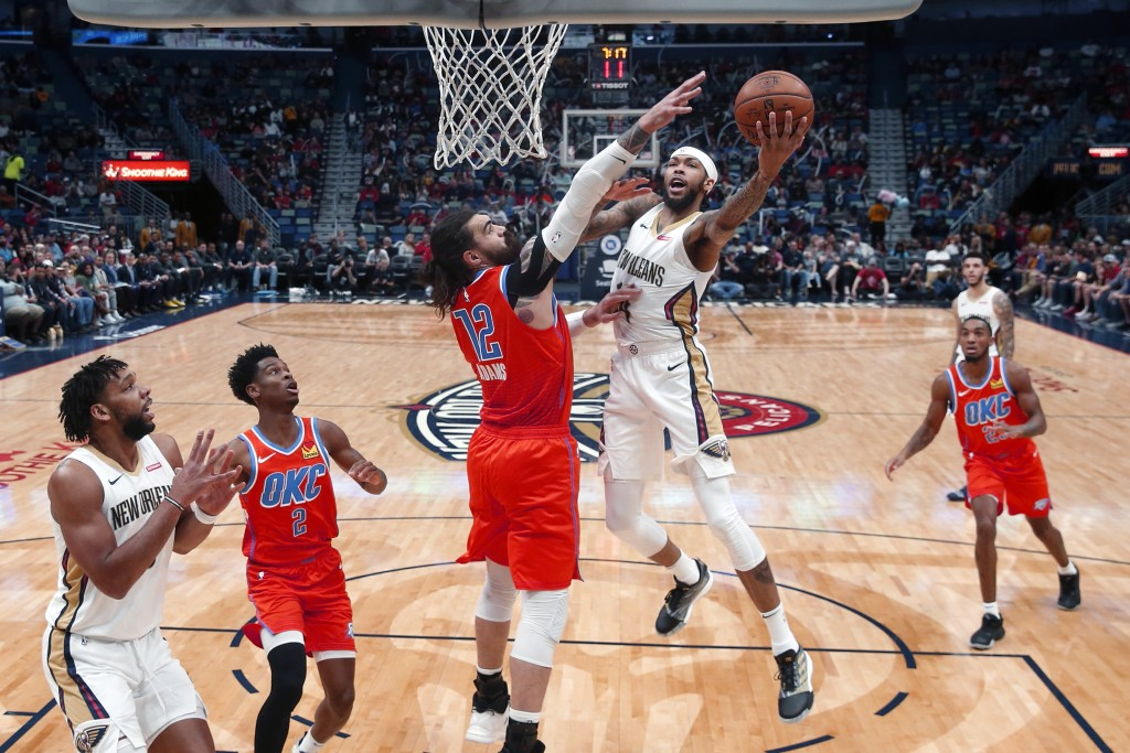 New Orleans Pelicans forward Brandon Ingram (14) goes to the basket against Oklahoma City Thunder center Steven Adams (12) in the first half of an NBA...