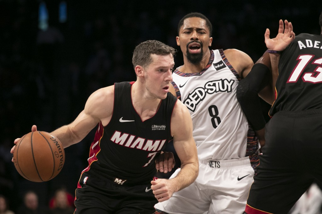 Miami Heat guard Goran Dragic (7) drives around Brooklyn Nets guard Spencer Dinwiddie (8) in the first half of a basketball game, Sunday, Dec. 1, 2019...