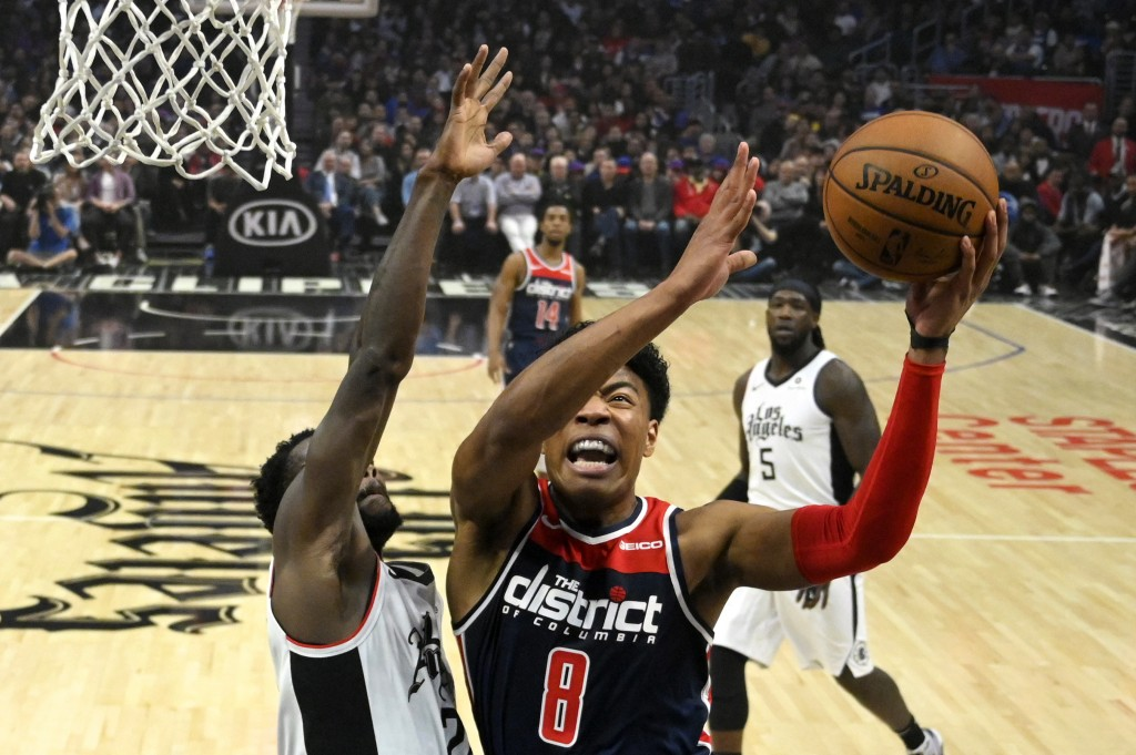 Washington Wizards forward Rui Hachimura (8), of Japan, shoots as Los Angeles Clippers guard Patrick Beverley defends during the first half of an NBA ...