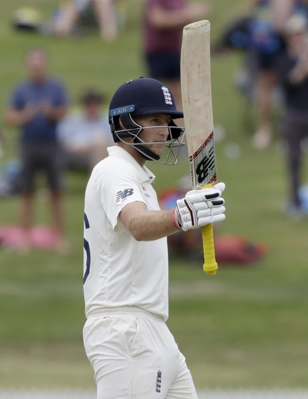 England's Joe Root gestures with his bat as he reaches 150 runs while batting during play on day four of the second cricket test between England and N...