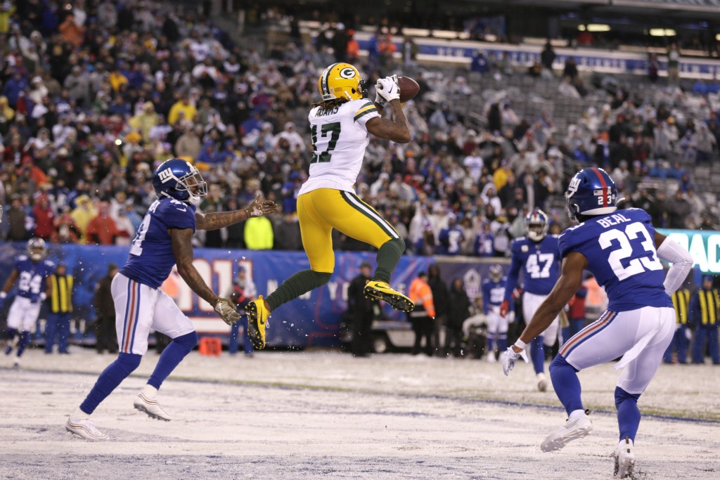 Green Bay Packers' Davante Adams (17) catches a touchdown pass during the second half of an NFL football game against the New York Giants, Sunday, Dec...