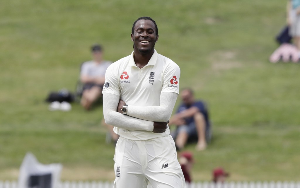 England's Jofra Archer reacts after teammate Joe Denly dropped a catch to dismiss New Zealand's Kane Williamson during play on the final day of the se...
