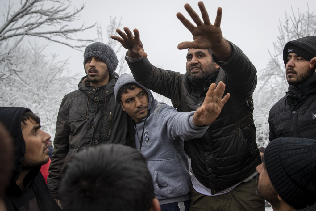 Migrants gather in protest of conditions at the Vucjak refugee camp outside Bihac, northwestern Bosnia, Tuesday, Dec. 3, 2019. Despite calls for their...