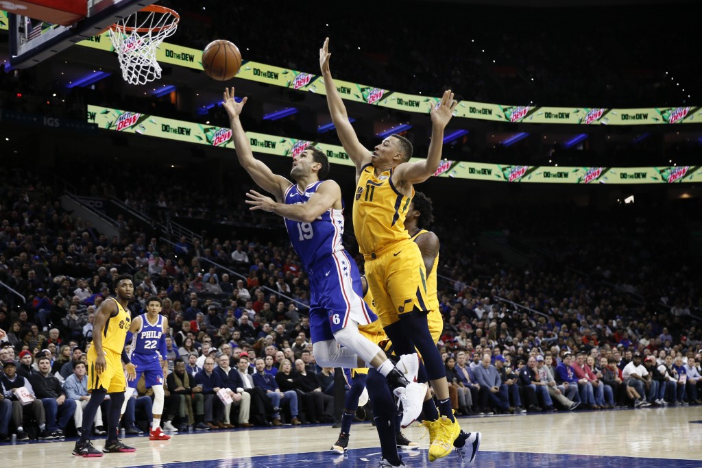 Philadelphia 76ers' Raul Neto (19) goes up to shoot against Utah Jazz's Dante Exum (11) during the first half of an NBA basketball game, Monday, Dec. ...