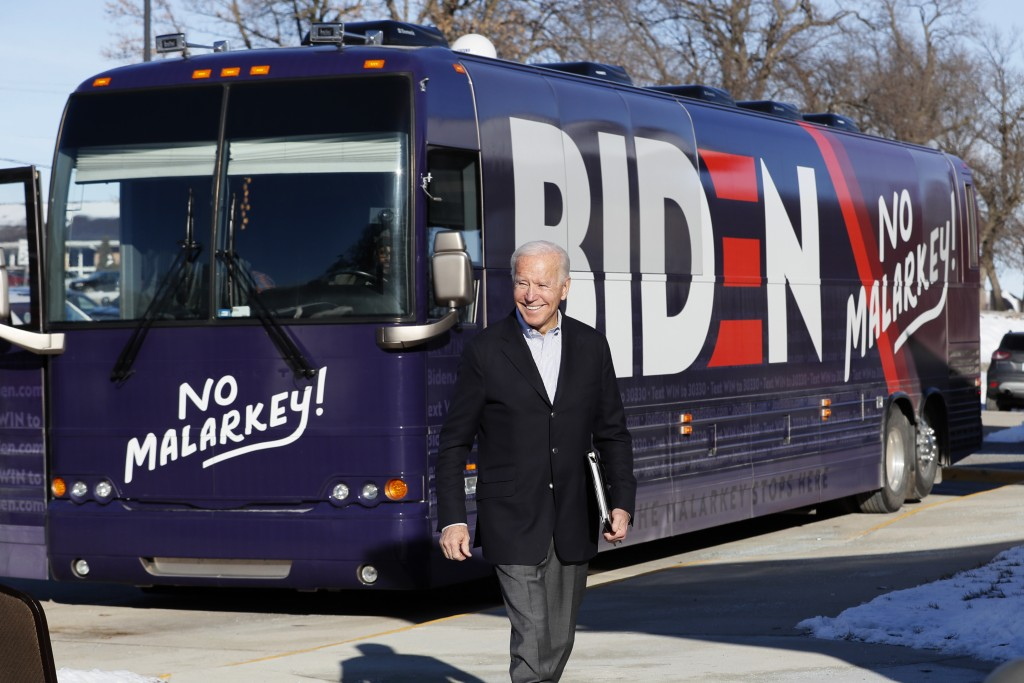 Democratic presidential candidate former Vice President Joe Biden arrives at a stop on his bus tour, Monday, Dec. 2, 2019, in Emmetsburg, Iowa. (AP Ph...