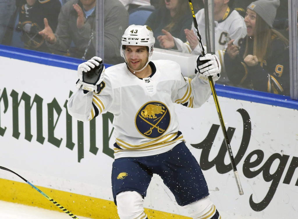 Buffalo Sabres forward Conor Sheary (43) celebrates his goal during the first period of an NHL hockey game against the New Jersey Devils, Monday, Dec....