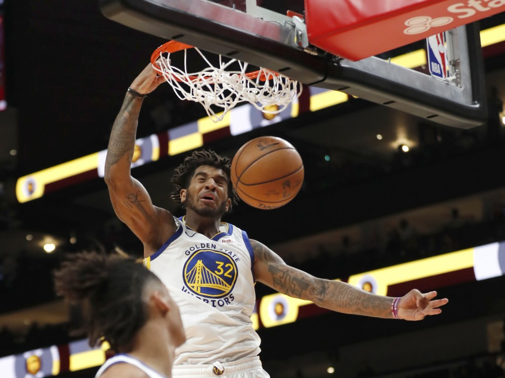 Golden State Warriors forward Marquese Chriss (32) scores in the second half of an NBA basketball game against the Atlanta Hawks, Monday, Dec. 2, 2019...