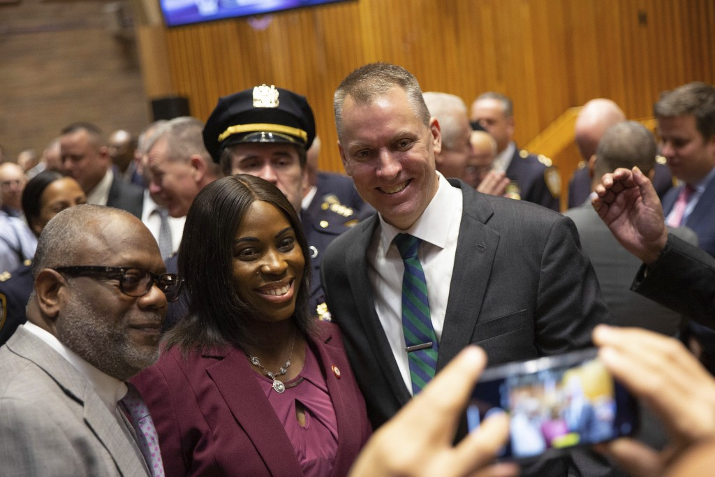Incoming Police Commissioner Dermot Shea, right, poses with colleagues at his swearing-in ceremony at police headquarters Monday, Dec. 2, 2019, in New...