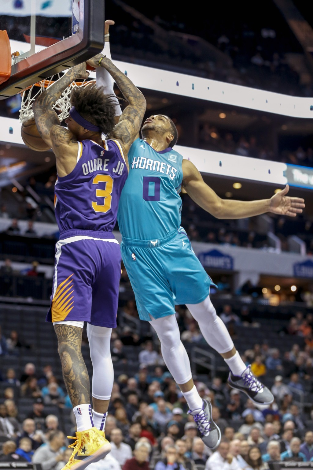 Phoenix Suns forward Kelly Oubre Jr. (3) dunks against Charlotte Hornets forward Miles Bridges (0) in the first half of an NBA basketball game in Char...