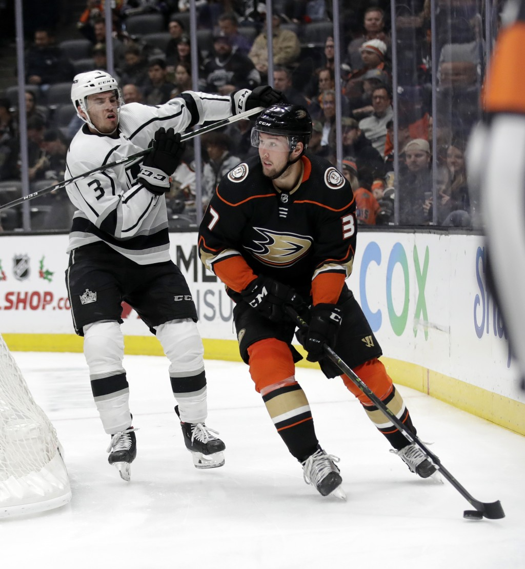 Anaheim Ducks' Nick Ritchie, right, is chased by Los Angeles Kings' Matt Roy during the second period of an NHL hockey game, Monday, Dec. 2, 2019, in ...