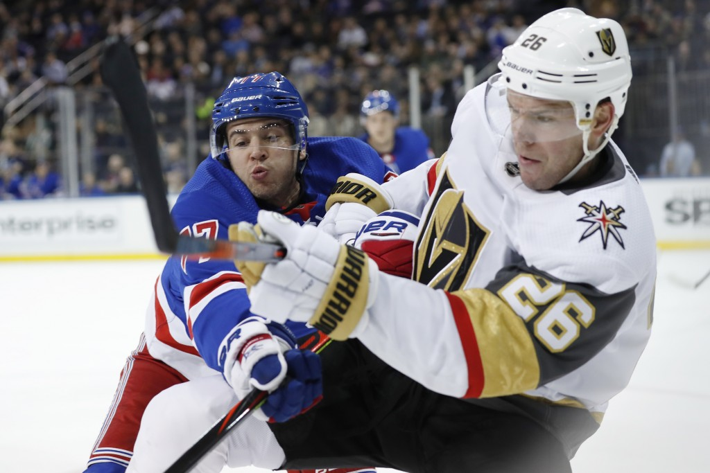 New York Rangers defenseman Tony DeAngelo (77) tries to stop a pass by Vegas Golden Knights center Paul Stastny (26) during the first period of an NHL...