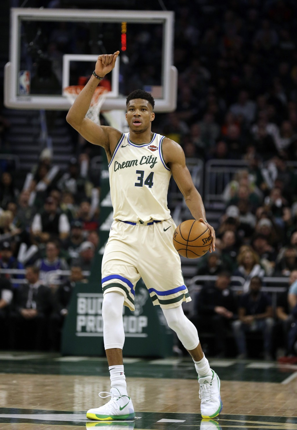 Milwaukee Bucks' Giannis Antetounmpo calls out a play against the New York Knicks during the second half of an NBA basketball game Monday, Dec. 2, 201...