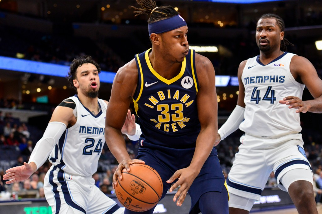 Indiana Pacers center Myles Turner (33) handles the ball against Memphis Grizzlies forward Solomon Hill (44) and guard Dillon Brooks (24)in the first ...