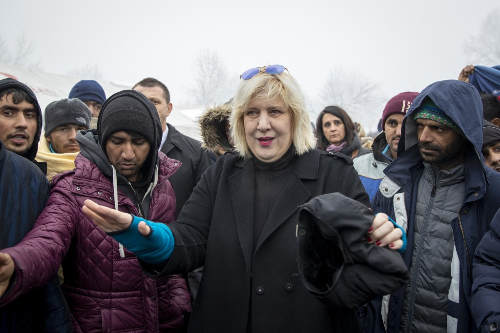 Dunja Mijatovic, the Council of Europe Commissioner for Human Rights, talks to a group of migrants at the Vucjak refugee camp outside Bihac, northwest...
