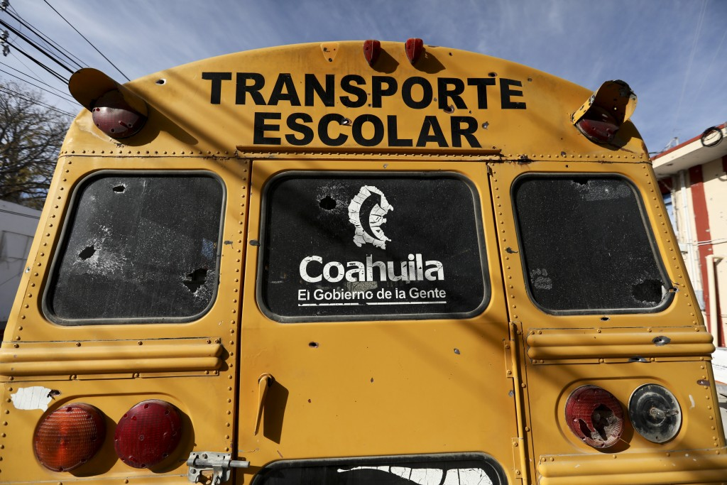 A school bus with bullet holes sits parked outside City Hall in Villa Union, Mexico in Monday, Dec. 2, 2019. The small town near the U.S.-Mexico borde...