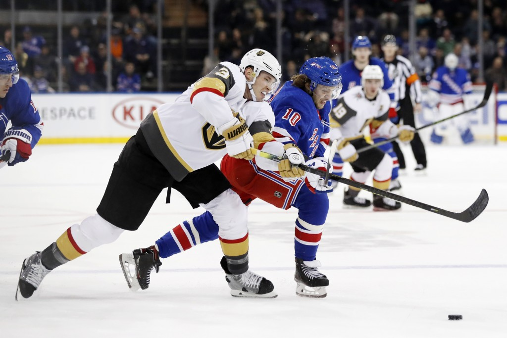 Vegas Golden Knights defenseman Brayden McNabb (3) and New York Rangers center Artemi Panarin (10) go after the puck during the second period of an NH...