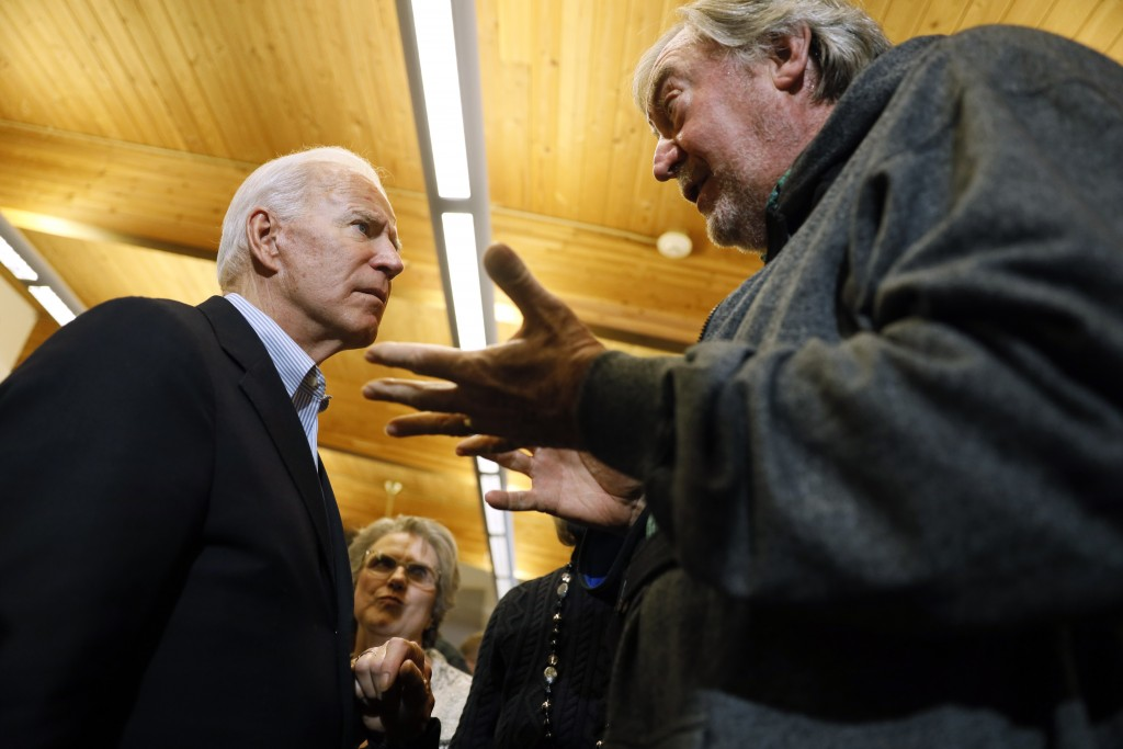 Democratic presidential candidate former Vice President Joe Biden talks with an audience member during a bus tour stop at Water's Edge Nature Center, ...