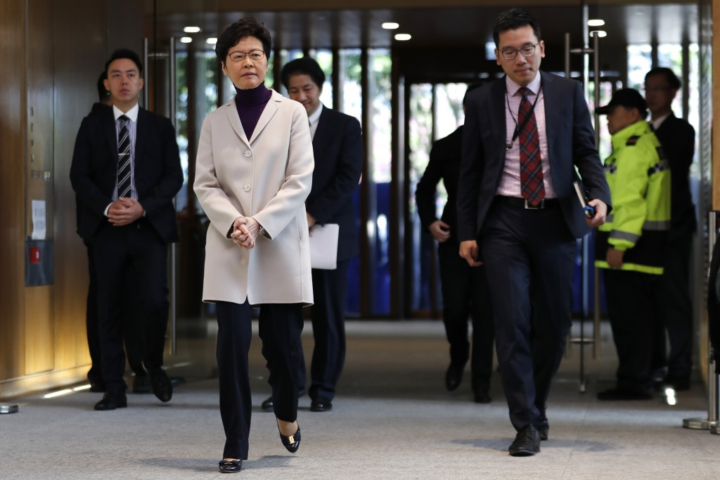 Hong Kong Chief Executive Carrie Lam, front left, arrives for a press conference at the Legislative Council in Hong Kong, Tuesday, Dec. 3, 2019. (AP P...