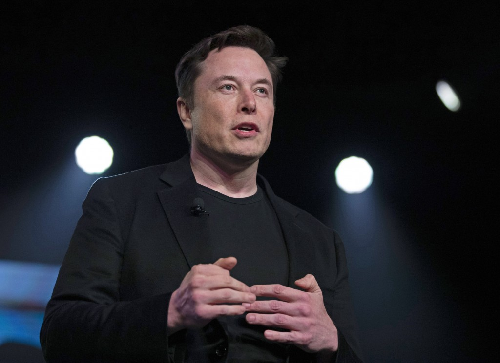 FILE - In this March 14, 2019, file photo, Tesla CEO Elon Musk speaks before unveiling the Model Y at Tesla's design studio in Hawthorne, Calif. Musk ...