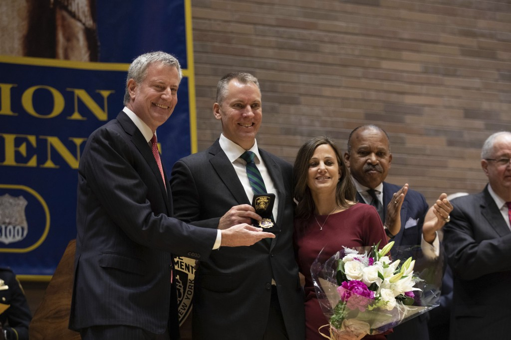 Incoming Police Commissioner Dermot Shea, center, poses with  his wife Serena Shea and Mayor Bill de Blasio, left, at his swearing-in ceremony at poli...
