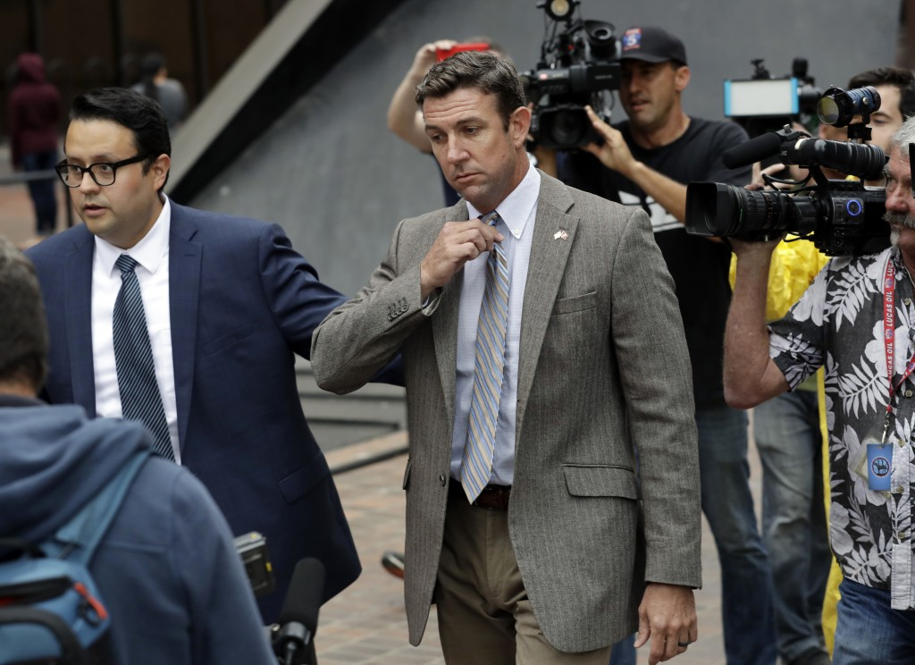 CORRECTS TO ATTRIBUTE THE REFERENCE TO HUNTER, NOT A JUSGE - FILE - In this Sept. 24, 2018, file photo, U.S. Rep. Duncan Hunter, center, leaves court ...