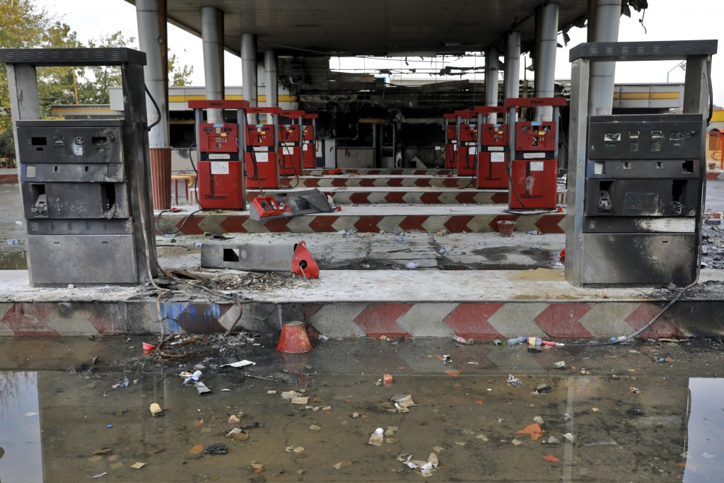FILE - In this Nov. 20, 2019, file photo, rainwater pools at a gas station attacked during protests over government-set gasoline prices in Tehran, Ira...