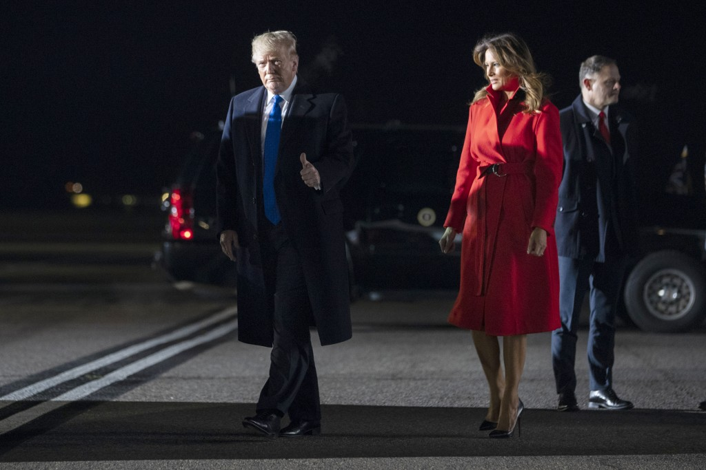 President Donald and first lady Melania Trump arrive at London Stansted Airport to attend the NATO summit, Monday, Dec. 2, 2019, in London. (AP Photo/...