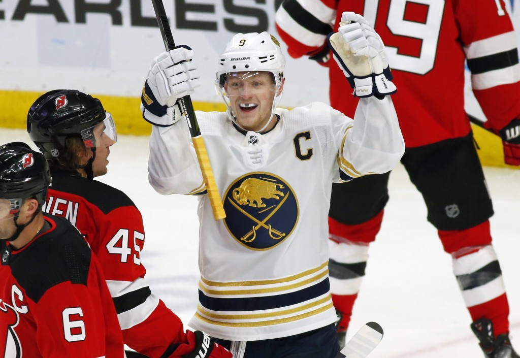 Buffalo Sabres forward Jack Eichel (9) celebrates his goal during the first period of an NHL hockey game against the New Jersey Devils, Monday, Dec. 2...