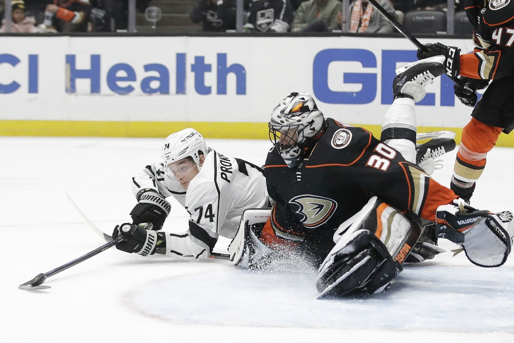 Los Angeles Kings' Nikolai Prokhorkin (74) tries to get the puck around Anaheim Ducks goaltender Ryan Miller (30) during the first period of an NHL ho...