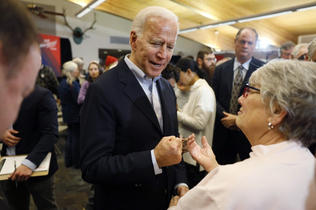 Democratic presidential candidate former Vice President Joe Biden talks with audience members during a bus tour stop at Water's Edge Nature Center, Mo...