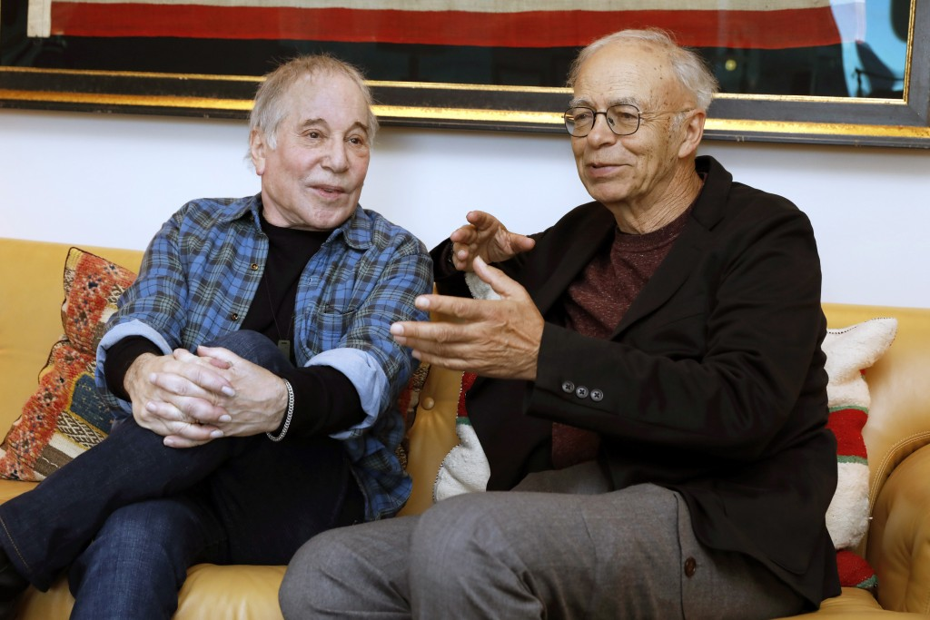 This Nov. 8, 2019 photo shows singer-songwriter, Paul Simon, left, and author-philosopher Peter Singer during an interview in New York to promote the ...