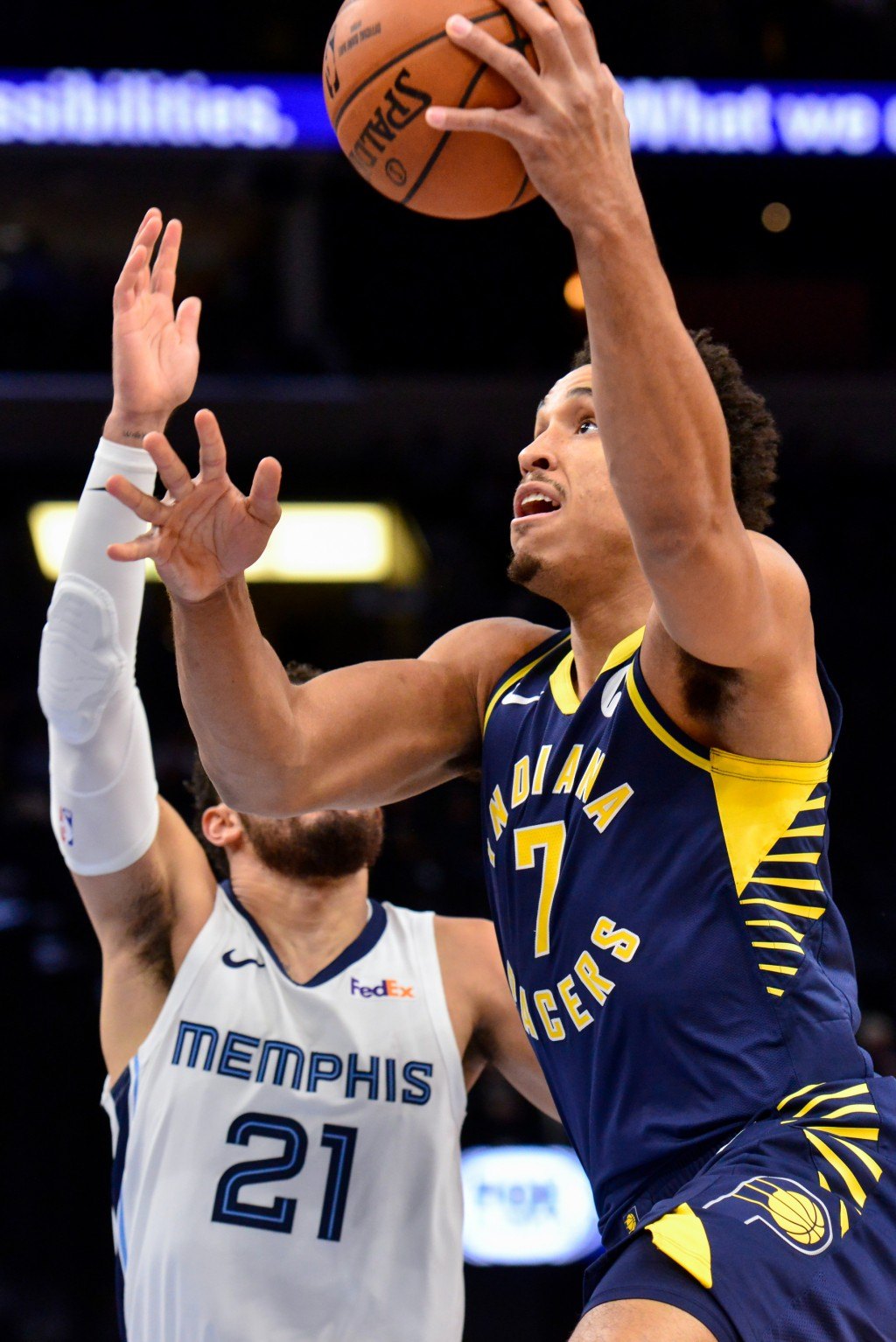 Indiana Pacers guard Malcolm Brogdon (7) shoots against Memphis Grizzlies guard Tyus Jones (21) in the first half of an NBA basketball game Monday, De...