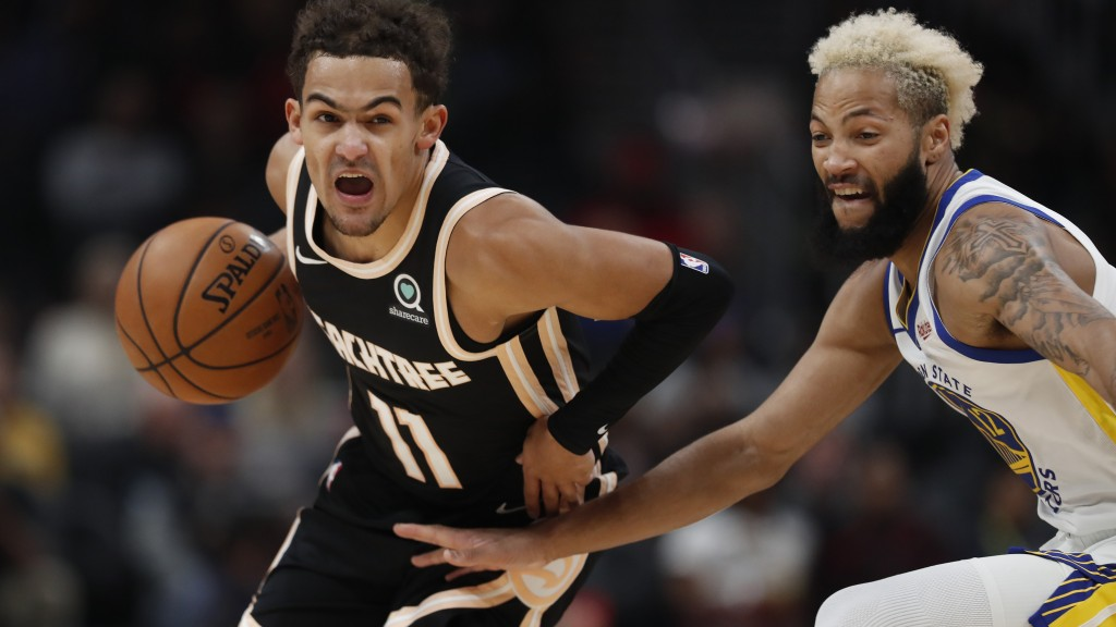 Atlanta Hawks guard Trae Young (11) drives against Golden State Warriors guard Ky Bowman (12) in the first half of an NBA basketball game Monday, Dec....