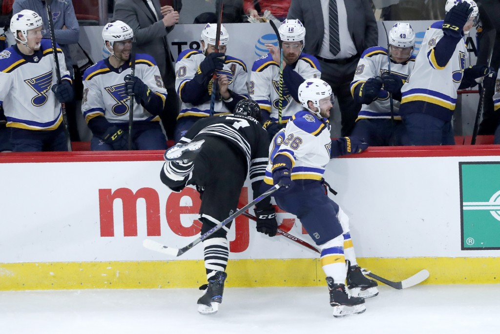 St. Louis Blues' Nathan Walker (26) sidesteps Chicago Blackhawks' Brent Seabrook, forcing Seabrook into the boards, during the second period of an NHL...