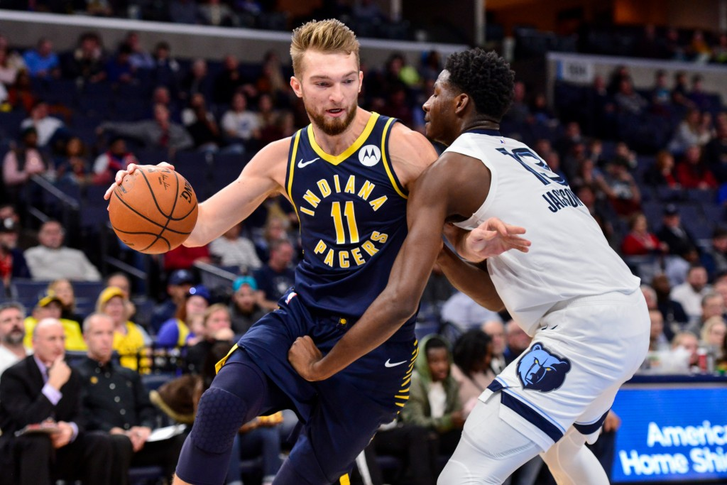 Indiana Pacers forward Domantas Sabonis (11) drives against Memphis Grizzlies forward Jaren Jackson Jr. (13) in the first half of an NBA basketball ga...