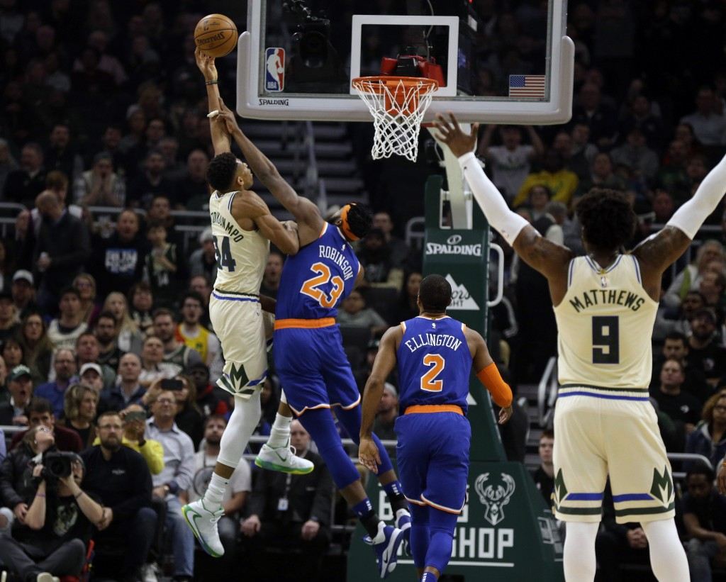 Milwaukee Bucks' Giannis Antetounmpo shoots against New York Knicks' Mitchell Robinson (23) during the first half of an NBA basketball game Monday, De...