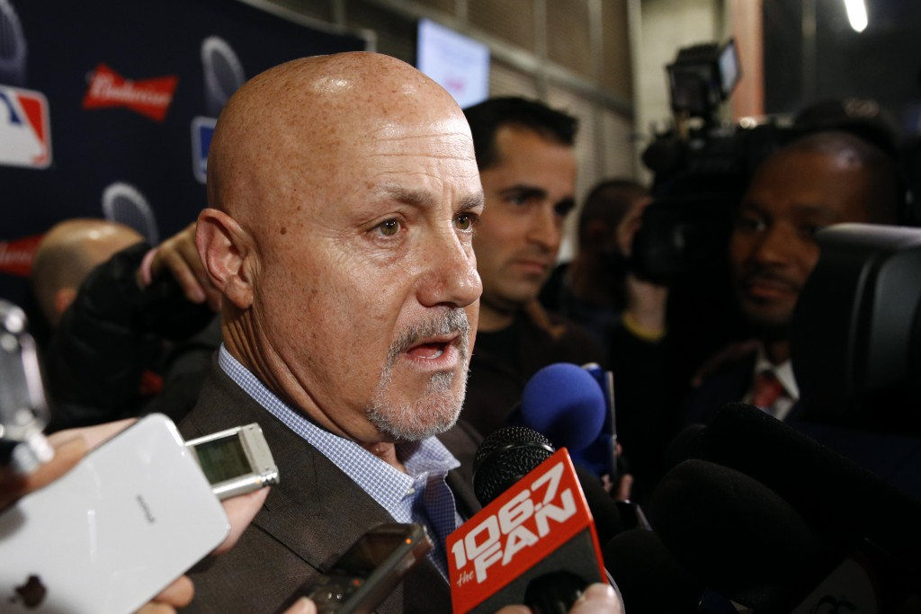 Washington Nationals general manager Mike Rizzo speaks with members of the media as he arrives for the premiere of a documentary film on the team's fi...