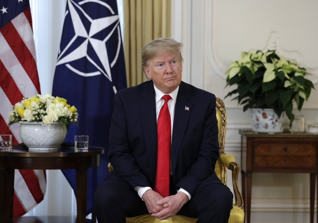 U.S. President Donald Trump meets NATO Secretary General, Jens Stoltenberg at Winfield House in London, Tuesday, Dec. 3, 2019. US President Donald Tru...